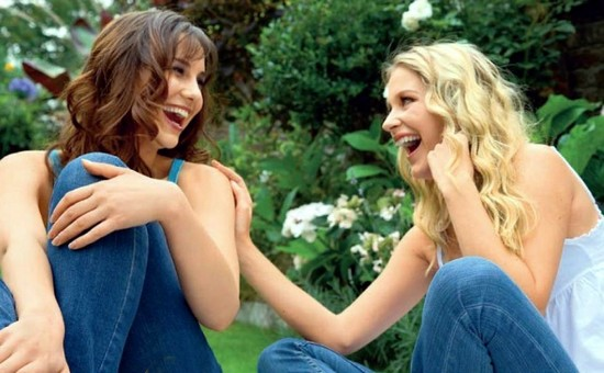 Beautiful girls laughing1 - 10 Surprising Benefits of Laughter You Need to Know