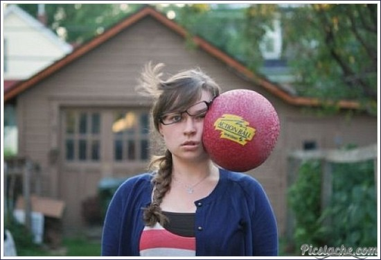She looks pretty indifferent as balls hit her face