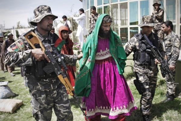 Militant Arrested in Women Dresses