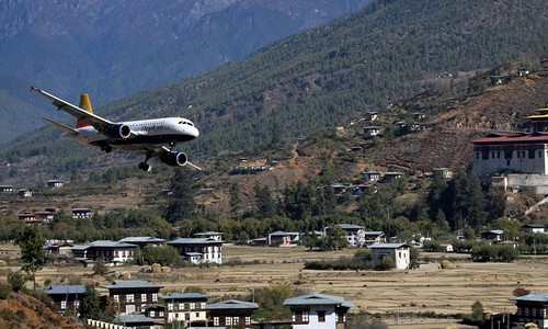 A Drukair - Royal Bhutan Airlines Airbus passenger jet prepares to land at the international airport in Bhutanese district of Paro