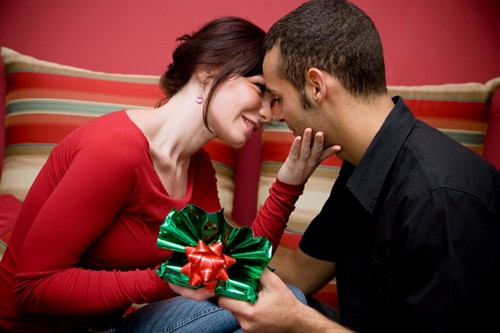 Sweet Couple Exchanging Gifts