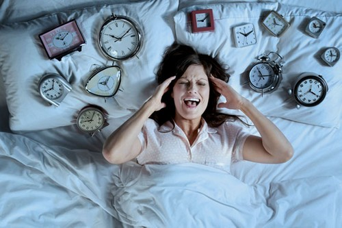 woman surrounded by clocks