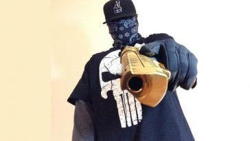 gun wielding masked man