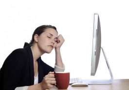 Woman sleeping at her desk at work